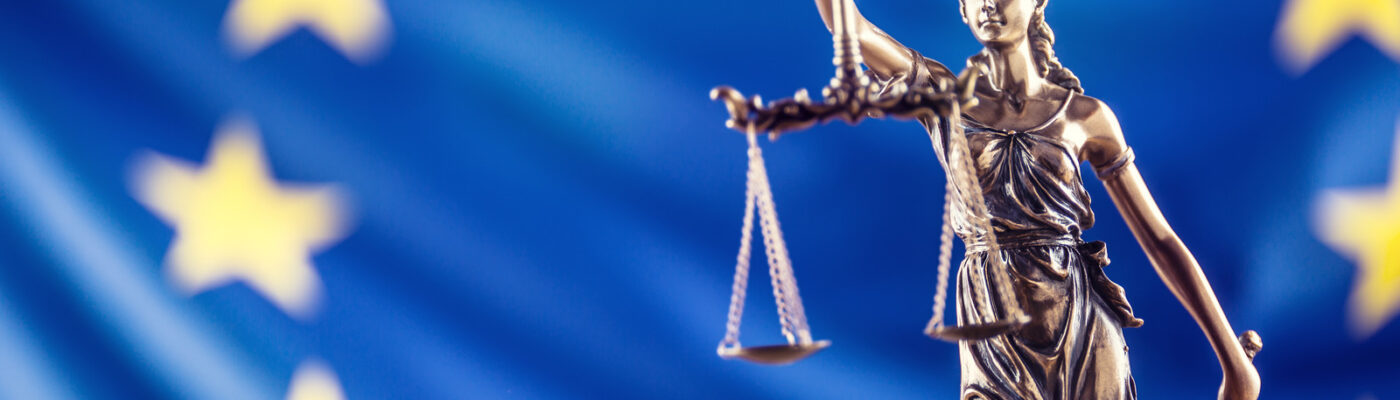 Lady Justice and European Union flag. Symbol of law and justice with EU Flag.